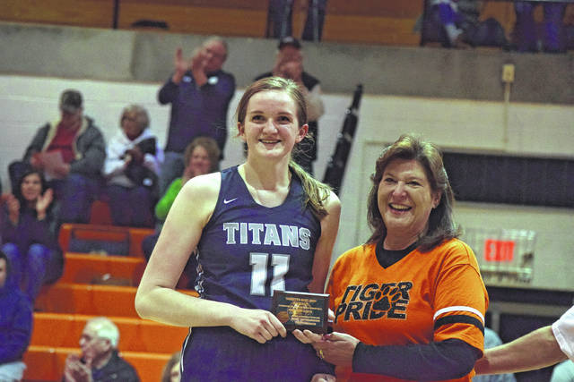Notre Dame's Katie Dettwiller poses after winning Tackett's Body Shop Player of the Game honors in a contest against Ironton.