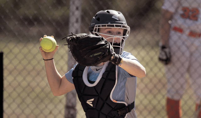 Former West High School graduate Megan Shupert-Martin fields her spot at catcher.