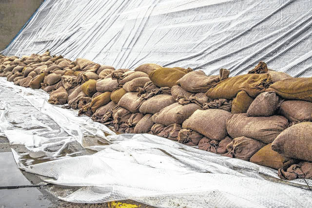 Sandbags fortify the Second Street floodgate in Portsmouth, one of the largest of the city's 15 floodgates.