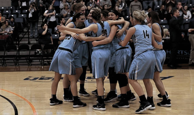 The Shawnee State University women's basketball program celebrates after winning the Mid-South Conference Tournament Championship.