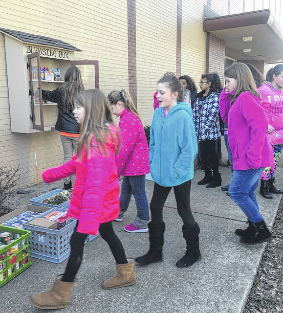 Portsmouth Elementary fifth graders lining up to help fill the Blessing Box