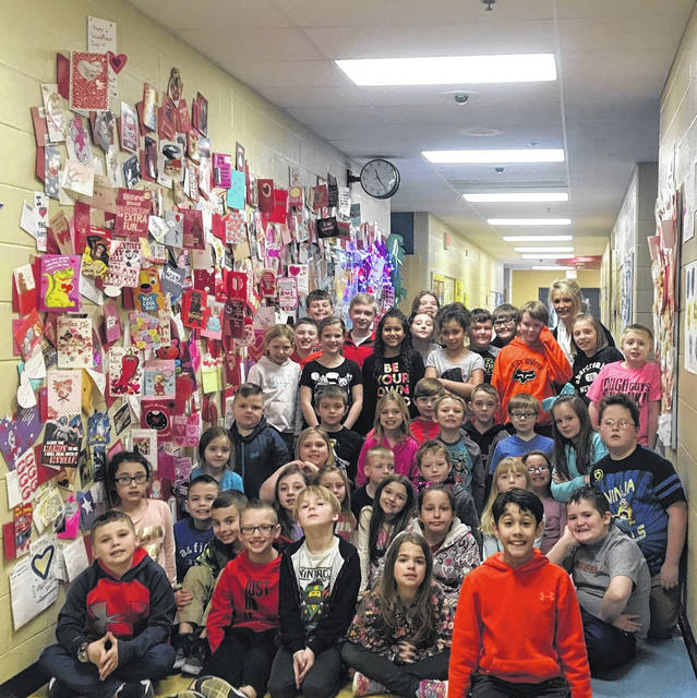 Brenda Strickland (right rear) with all the third graders beside their giant heart wall at Clay Elementary.