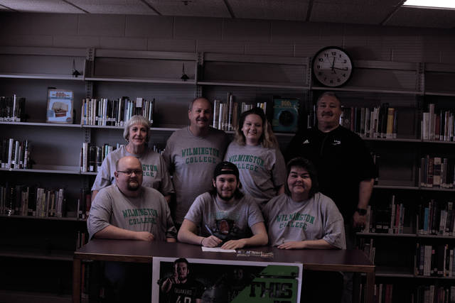 Valley's Bayden Sullivan signed with Wilmington College on Friday evening. Pictured in front left to right: Matt Sullivan (father), Bayden, Connie Sullivan (mother). Pictured from back, left to right: Debbie Sullivan (grandmother), Tom Sullivan (grandfather), Victoria Sullivan (sister), Darren Crabtree (Valley head football coach, athletic director)