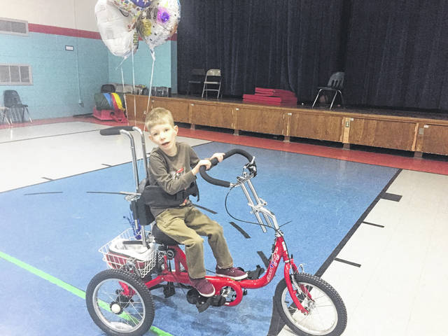 8-year-old Brendon Johnson takes a victory lap around the Vern Riffe gymnasium.