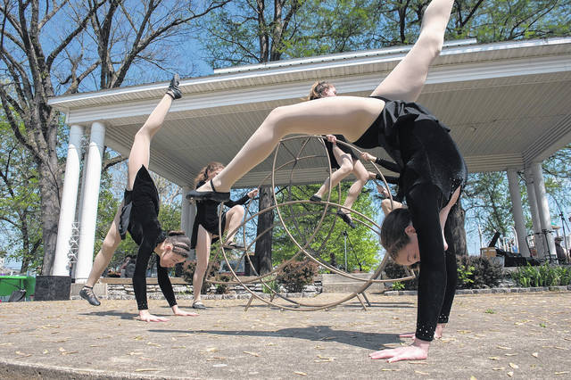 """We have beauty in this town year-round. There's a magic here that doesn't really happen in other communities,"" photographer Toni Dengel told those who attended Thursday's ""Visualizing Appalachia"" program at Shawnee State University. This is Dengel's photo of members of Cirque d'Art."