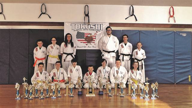 Students from the Dogwood Ridge Tokoshi Martial Arts Dojo participated at the AKJU 50th Anniversary Ohio State Karate, Ju-Jitsu and Iaido Championship in Chillicothe, Ohio on March 24 and April 15th, as well as the annual Cobra Karate Championship in Jackson, Ohio on April 7. Pictured in the front row, from left to right: Joshua Lawson, second, Kata (Jackson), Nicholas Sylvia, first, Kata (Chillicothe and Jackson), first, weapons (Chillicothe and Jackson) and third, Kumite (fighting) in Jackson, Oksana McWharter second, Kata (Jackson), Carson Campbell, second, Kata and first, fighting (Chillicothe), Payton McWharter, third, Kata, and first, fighting (Jackson), Trevon King, second, Kata, first, weapons and first, fighting (Jackson) and Sydney Little, first, Kata and first, weapons (Jackson). In the back row, from left to right: Jonathan Bailey, second, Kata (Chillicothe), Megan Conley, first, Kata, second, weapons, and first, fighting (Jackson), Victoria Thomas, second, Kata, first, weapons, first, fighting and Grand Champion Women's Black Belt division in fighting (Chillicothe), Chase Wagner, second, Kata (Chillicothe), first, Kata and Grand Champion Men's Black Belt Division for Kata (Jackson), third, weapons (Chillicothe), first, weapons and Grand Champion for weapons (Jackson), first, fighting Men's Black Belt (Chillicothe) and second, fighting (Jackson), Alexander Thomas (Chillicothe), and Staci Lansky, first, Kata, and third, fighting (Chillicothe), and Kayla Sammons (not pictured) first, Kata, weapons and fighting (Jackson).