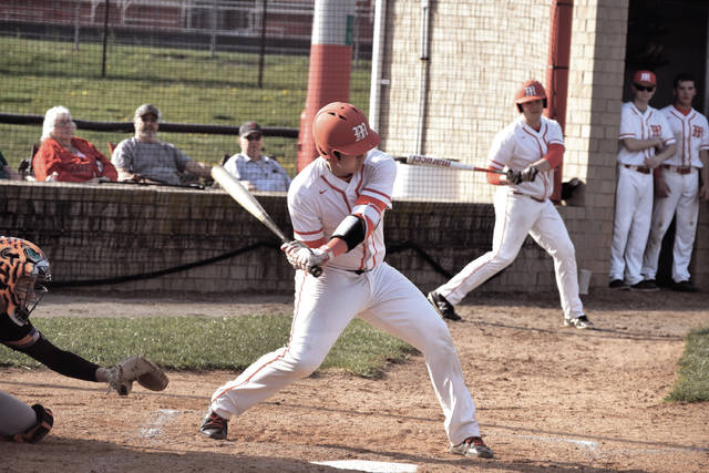 Minford's Luke Lindamood reaches down for a pitch in the middle innings of a 12-inning affair against Waverly.