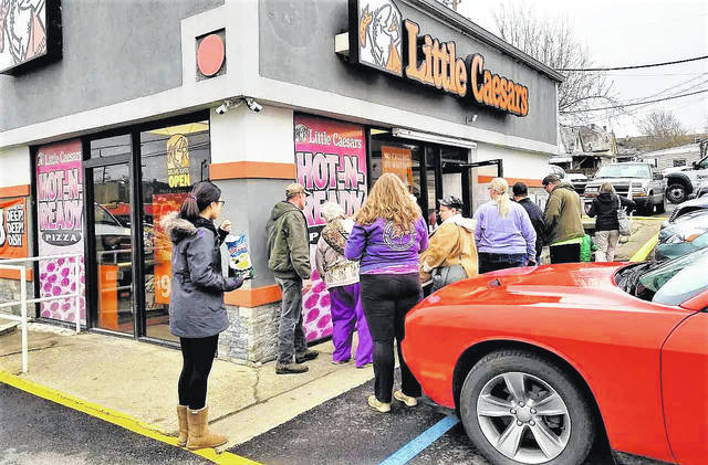 Customers eager to cash in on Monday's free pizza giveaway were lined up at Portsmouth's Gallia Street Little Caesars location.