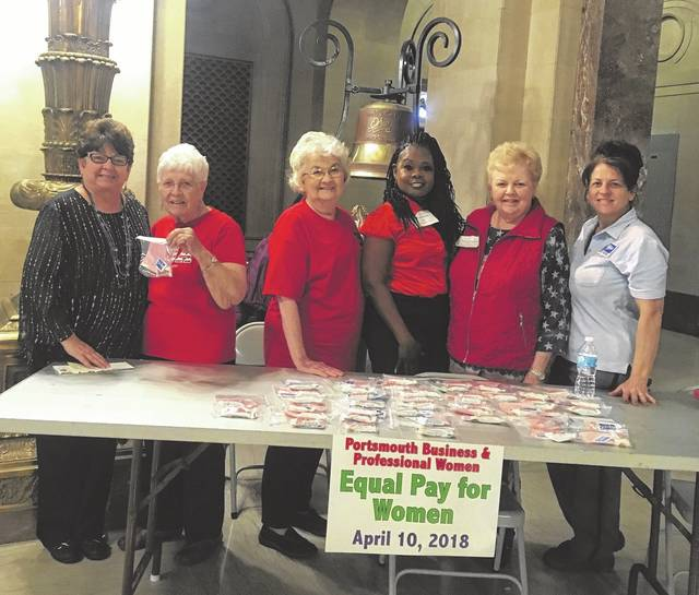On hand to support women's right to equal pay were (from left) Scioto County Commissioner Cathy Coleman, Shirley Powell, Annita Thompson, Portia Williams, Karen Evans and U.S. Postal Service employee Kelle Riffe.