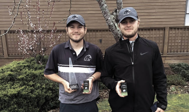 Shawnee State's Jordan Tieman (left) and Dagan Abdon (right) stand with their trophies following the UPike Spring Invitational.