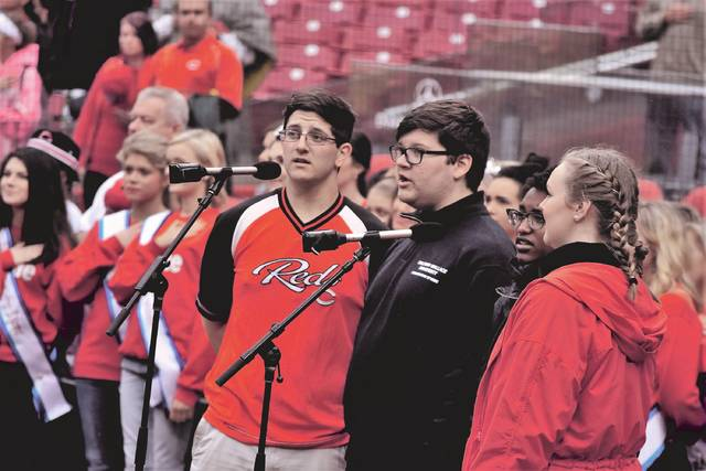 Portsmouth High School students Zach Kinney, Micah Simmons, Sarah Simmons, and Sara Born sign a rousing rendition of the Star-Spangled Banner.