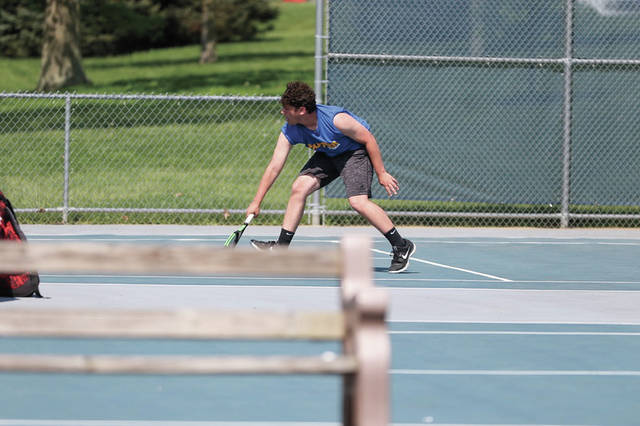 Clay's Gage Keller fields a low volley.