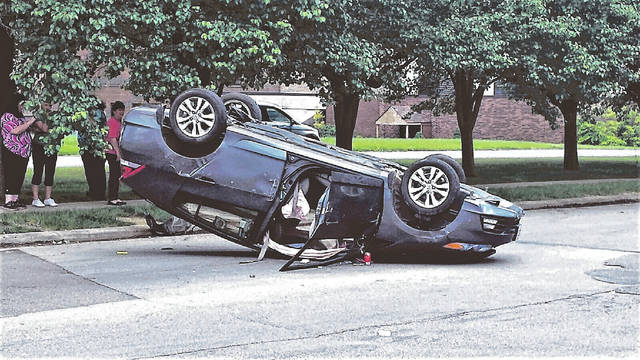 A 2013 Honda Hybrid sits on its top after striking a 2013 Chevrolet Malibu Monday afternoon on Kinney's Lane in Portsmouth.