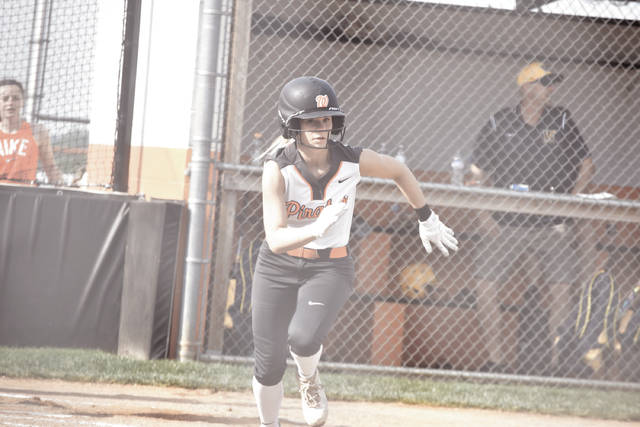 Wheelersburg's Addi Collins sprints out of the batter's box after notching a base hit against Wellston.