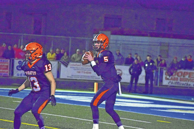 Wheelersburg's Trent Salyers drops back to pass.