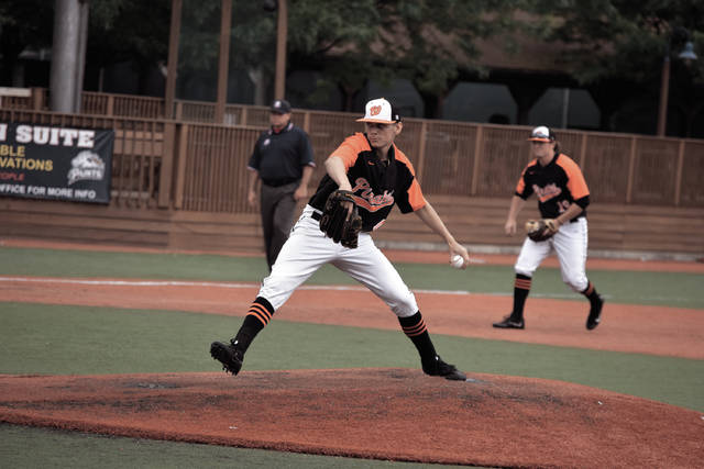 Wheelersburg's Trey Carter begins to come towards the plate with his pitch.