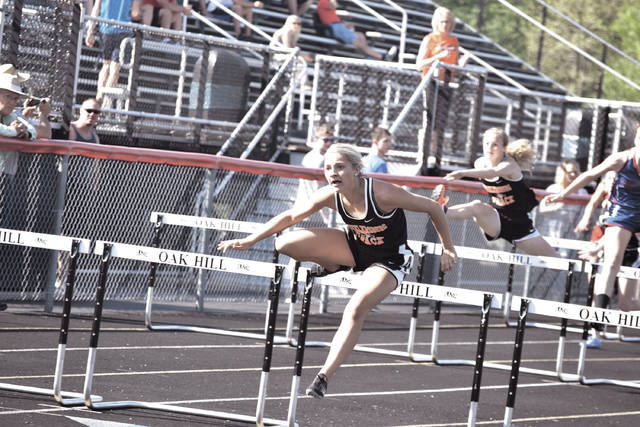Wheelersburg's Ellie Ruby clears the final hurdle en route to taking home another victory.