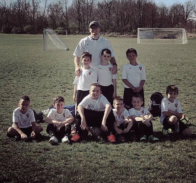 Braxton Jarvis with his First Capital Football Club players. The Wheelersburg native, who played for the Pirates' boys soccer program and earned All-State honors before moving onto stints at Capital and Shawnee State, was named as the head coach of the West Senators' soccer program earlier in the month.