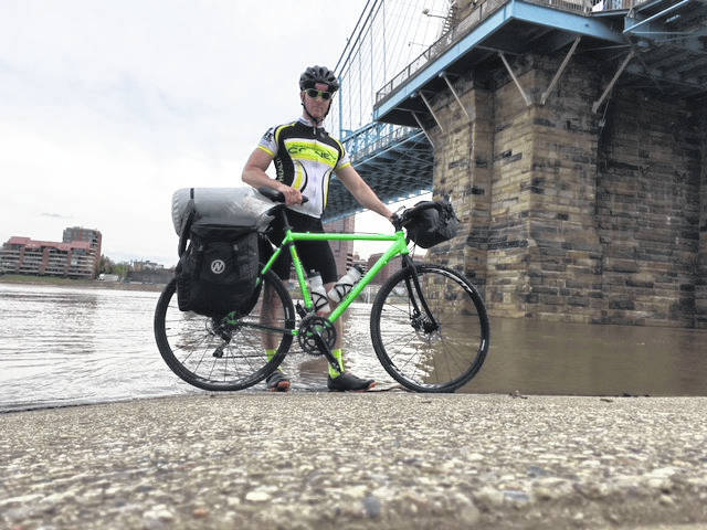 Having reached his goal, Mullins marked the accomplishment by dipping one of his bike tires in the Ohio River.