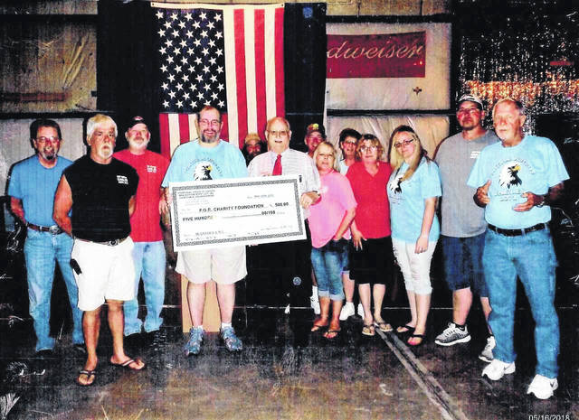 Grand Worthy President (GWP) Tom McGrath (center) receives a donation of $500 from members of New Boston Eagles Aerie 2271 designated to benefit the Eagles' campaign to cure diabetes.