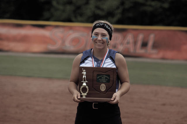 Clay's Julia Swain poses with the Division IV, Rio Grande I District Championship trophy.