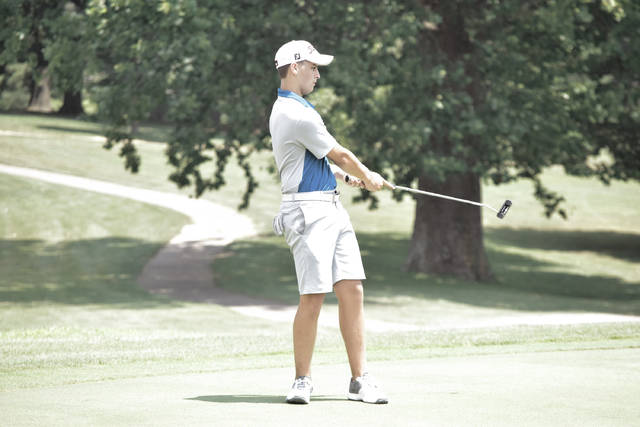 Nicholas James watches a putt as it heads toward the hole.