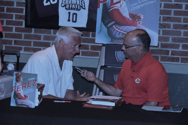 Former Major League Baseball player Tracy Jones (left) and Mark Williams (right) talk on Tuesday evening before the start of the Cincinnati Reds' HOF Portsmouth Chapter meeting at Buffalo Wild Wings in Portsmouth.