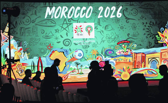 "FILE - In this Saturday March 17, 2018 file photo, a giant screen display the logo of Morocco 2026 inside of the reception before a press conference to promote Morocco's bib for the 2026 soccer World Cup in Casablanca, Morocco. The North American bid to host the 2026 World Cup has outscored Morocco following inspections with FIFA labeling the North African proposal ""high risk"" in three areas, it was announced on Friday, June 1. The joint bid from the United States, Canada and Mexico scored four out of five while Morocco scored 2.7 following FIFA inspections. (AP Photo/Abdeljalil Bounhar, file)"