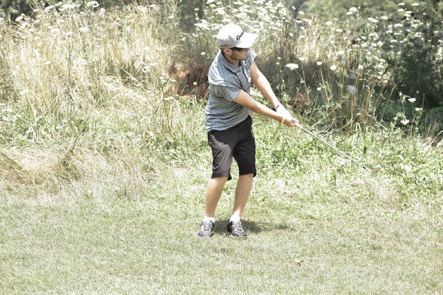 West Union's Jacob Pell launches a ball from the rough during Tri-State Junior Golf Tour play on Monday at Shawnee Golf Course in Friendship.