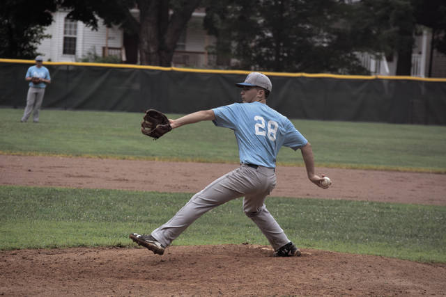 Post 23's Jared Morrow extends before coming to the plate with his pitch.