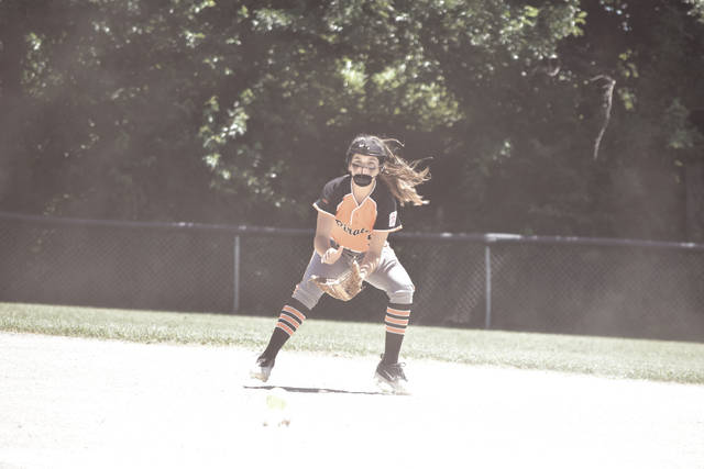 Wheelersburg's Sydney Salyers fields a ball during pregame warmups.