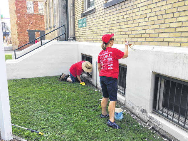 More volunteers paint at Children's Services.