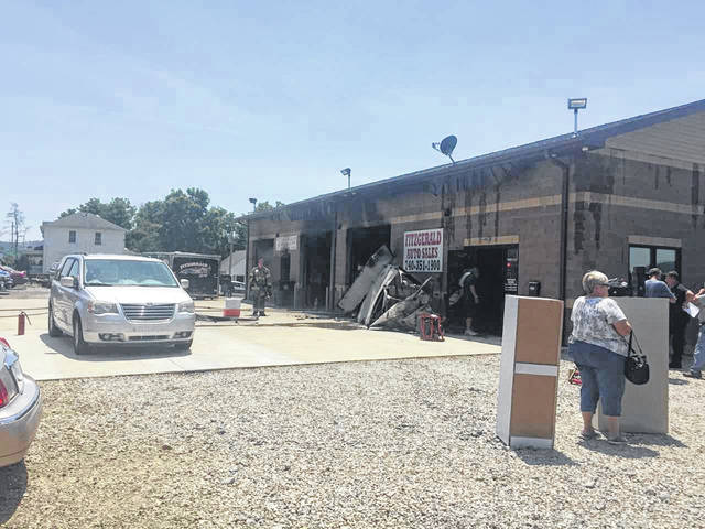 Firefighters battled a blaze at Fitzgerald Auto Sales Wednesday afternoon.