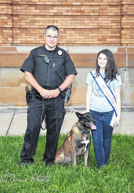 Morgan with the K-9 unit that worked at her event