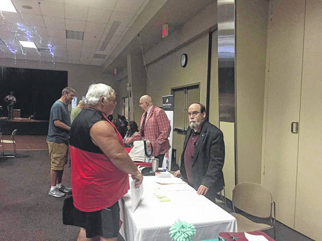 Ray Weeks, of West Union, a 40 year employee of the Portsmouth Gaseous Diffusion Plant, talks with Dr. David Manuta, president of Manuta Chemical Consulting at the health fair last week conducted by Cold War Patriots.