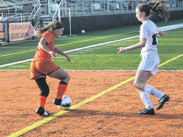 Christen Risner attacks the Greenup defense in Wheelerburg's 10-0 victory.