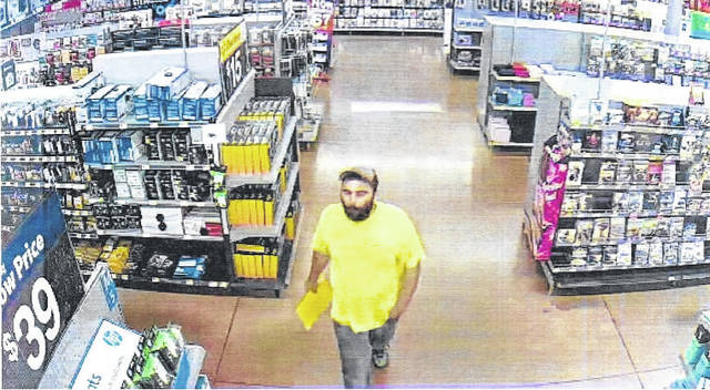 New Boston Police provided two closed circuit TV photos of the man they believe robbed the New Boston Walmart early Sunday morning.
