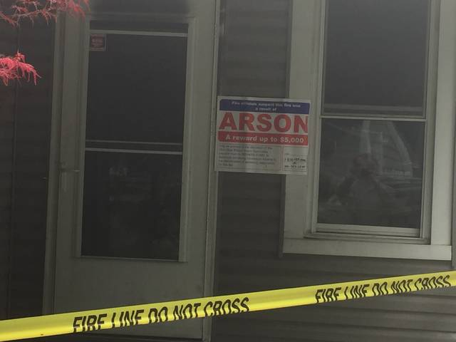 A sign was placed on the front of a structure on Grandview Ave. Monday indicating the fire here was arson. The blaze is being investigated by the Ohio State Fire Marshal's Office.