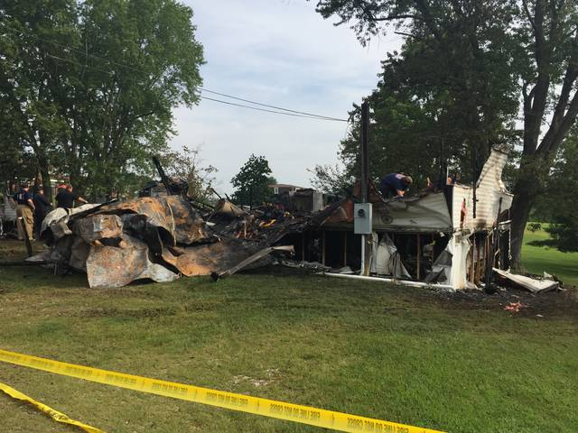 A Wheelersburg fire claimed the life of a man and his toddler son early Friday morning.