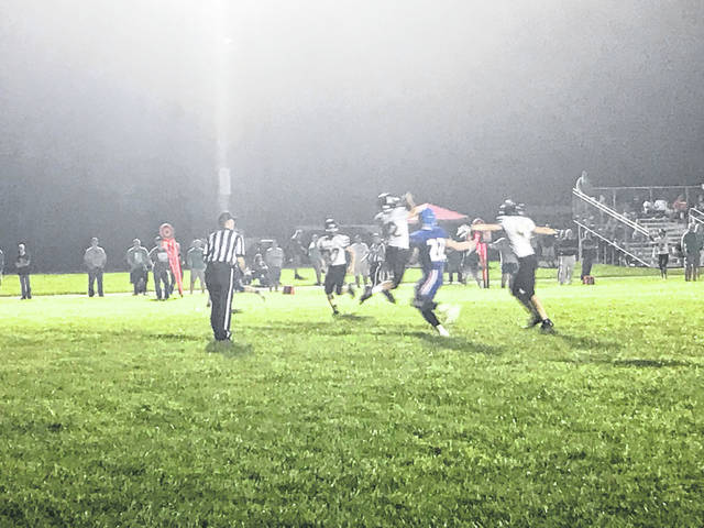 Sophomore Tanner Fortson records a late game interception against Lewis County.