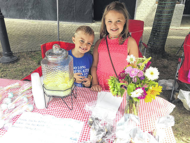 Abi and Steven Whitt at their stand at the Main Street Farmer's Market
