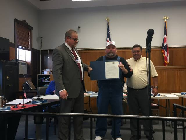 "Kevin E. Johnson presents True Lure ""No Kill"" Deer Hunt Proclamation to Todd Dunn and Mike Bell."