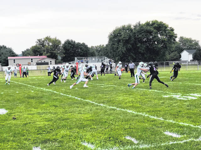 Green running back Alec Smith runs the ball against Dohn Community