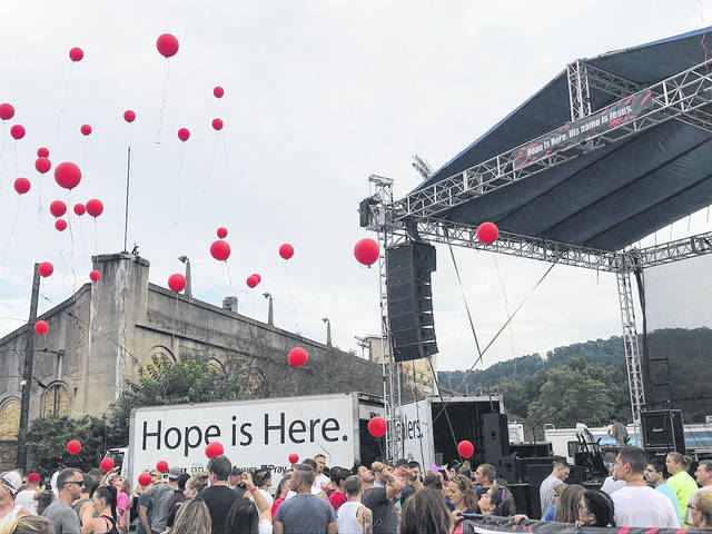 The gathered crowd released red balloons in memory of those lost to addiction.