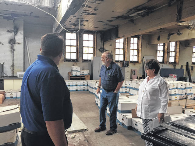 Scioto County Commissioners Bryan Davis, Cathy Coleman and Mike Crabtree look at the 4th floor area of the courthouse which needs serious reconstruction.