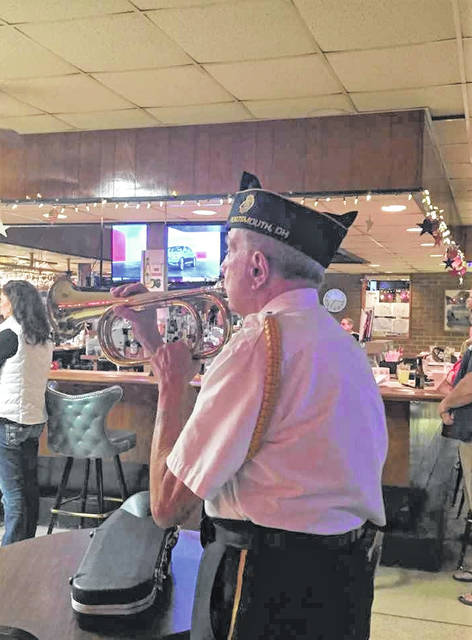 Dr. Robert Nelson plays Taps on the bugle at the American Legion Post 23 Thursday evening.