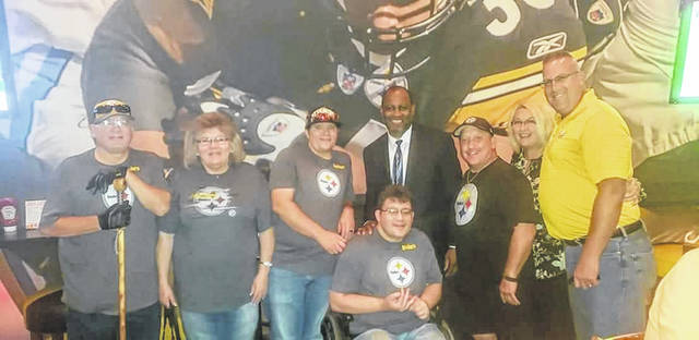 DJ Wise and his mother and father meeting with Steelers Hall of Famer, Dwayne Woodruff during their trip to Pittsburgh last month.