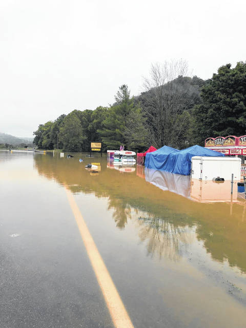 Festival trailers and tents become submerged in flood waters during the Whitetail Deer Festival in Rarden Saturday afternoon.