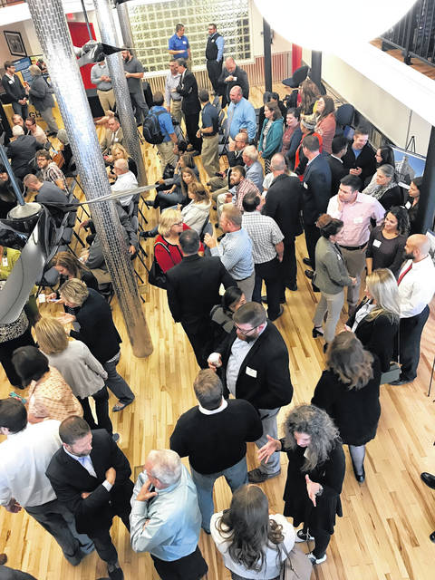 The main lobby and the upstairs balcony of the new Kricker Innovation Hub were packed during the opening ceremony for the hub Friday.