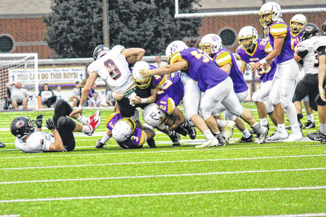 A host of Indian defenders bring down the Hornets ball carrier Friday night.